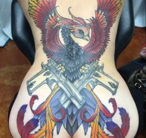 wicked tattoos phoenix guns back tattoo