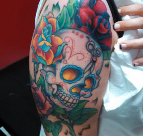 wicked tattoos floral skull upper arm tattoo